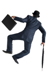 businessman jumping and kicking his heels isolated on white