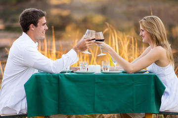 beautiful young couple having romantic dinner