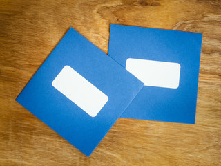 two plain blue windowed envelopes