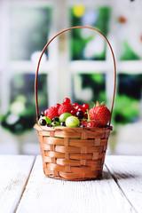 Forest berries in wicker basket,