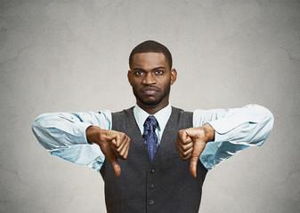 Displeased customer executive man giving thumbs down gesture