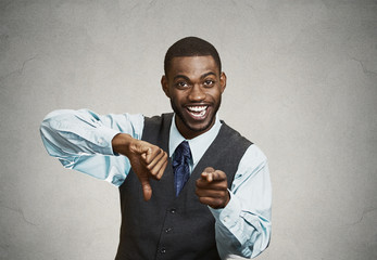 Company man excited about someones failure, grey wall background