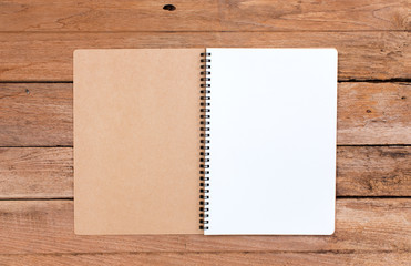 Blank notebook on old wood background