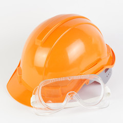 Orange Safety helmet and goggles