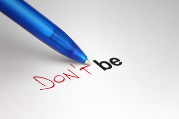 Don't be. Written on white paper