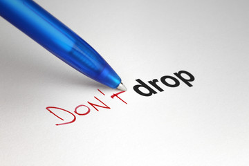 Don't drop. Written on white paper