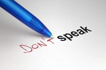 Don't speak. Written on white paper