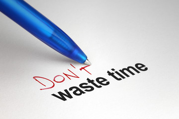Don't waste time. Written on white paper