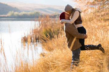 young couple kissing in autumn