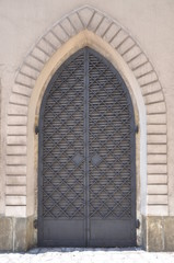 Iron door and stone wall