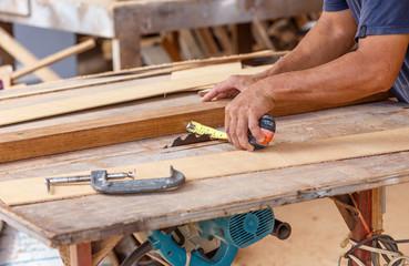 carpenter use saw cut wood formake new furniture
