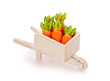orange toy carrot in a wooden shopping cart  with Clipping Path