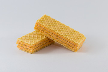 Two waffles on a white background