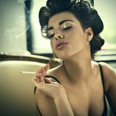 Retro style smoking fashion woman portrait on arm chair