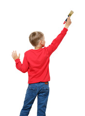 Little boy with paintbrush on wall, back view
