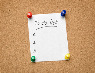A To Do List pinned to a cork notice board as an aid to efficien