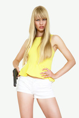 Cute young woman holding gun