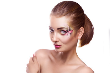 Pretty caucasian female with flower makeup on eyes in studio