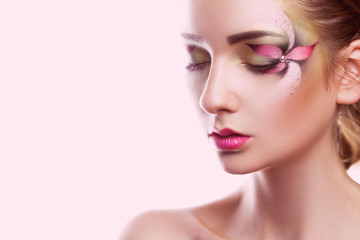 Sensual portrait of young woman with creative make up