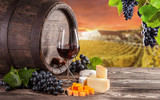 Red wine still life with vineyard on background - Fine Art prints