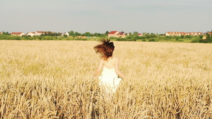 Woman running through wheat field, super slow motion, 240fps