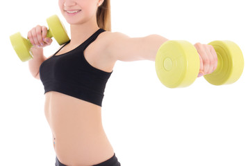 young woman holding dumbbells isolated on white
