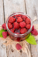 Glass with Canned Raspberries