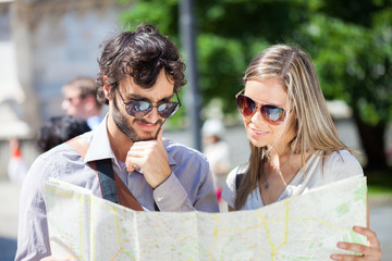 Couple of tourists reading a map