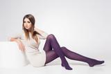 beautiful woman with long sexy legs wearing stockings posing