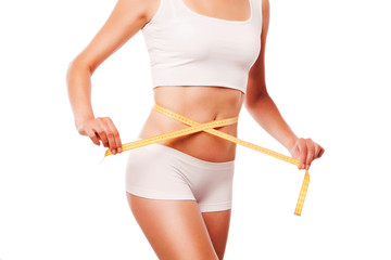 Woman measuring perfect shape. Healthy lifestyles concept. on