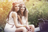 Two beautiful boho girl in the park poster