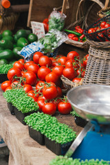 Fresh tomatoes and green vegetables in the market
