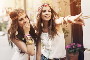 Two boho girls have fun in summer day