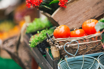 Fresh tomatoes and flowers at the market
