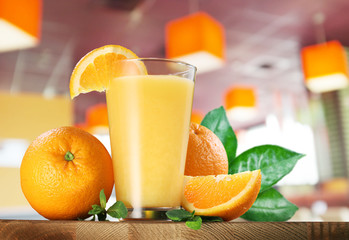 Orange fruits and glass of orange juice.