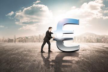 businessman is pushing huge euro icon