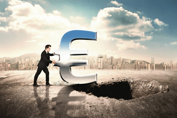 Businessmen pushing icon of euro into a hole in the ground