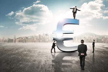 businessmen around huge euro icon