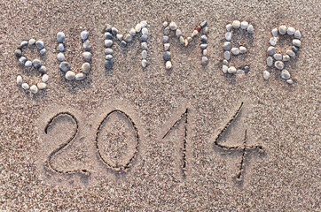 "Word ""Summer"" made with marine shingles over sea sand."
