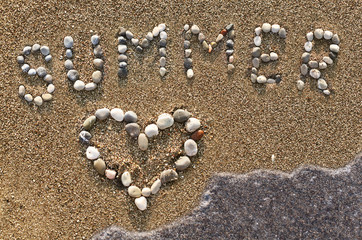 "Word ""Summer"" and heart symbol made with marine shingles."