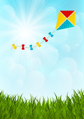 Color paper kite on sunny background