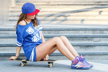 Beautiful girl with skateboard