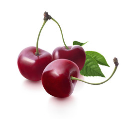 Three cherries and leaf isolated on white background