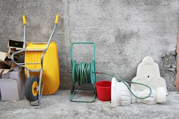 Wheelbarrow, hose and cartons