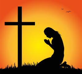 silhouette di donna che prega