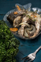 fragrant roasted fish in sauce and spices
