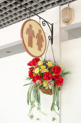 toilet signs with bouquet