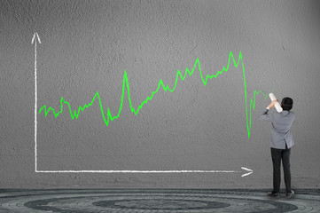 Business man drawing investor stock index graph