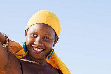 Cheerful African woman enjoying life.