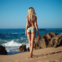 Sexy blonde on sea